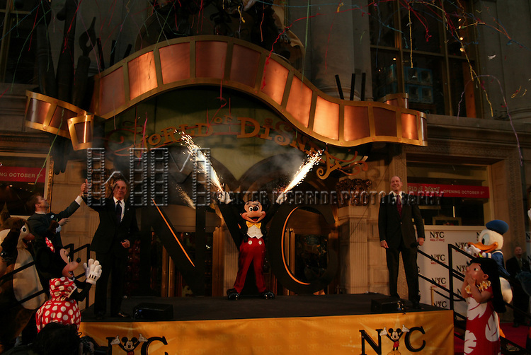 Mayor Michael Bloomberg .with Michael Eisner and Mickey Mouse.Attending the Grand Opening Celebration of The World of Disney Flagship Store on Fifth Avenue in New York City..October 4, 2004.© Walter McBride /