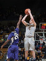 Sam Singer of California shoots the ball during the game against Washington at Haas Pavilion in Berkeley, California on January 15th 2014.  California defeated Washington, 82-56.