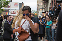 NEW YORK JUNE 13: A man and a woman embraces each other during the vigil at the Stonewall Inn, a historic gay bar, to pay tribute to the victims of the massive shooting in a gay nightclub in Orlando, Florida. New York June 13, 2016<br />  Photo by VIEWpress/Maite H. Mateo.