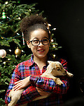"Prospect, CT- 22 December 2016-122216CM02- Naccea Gordon 10 of Waterbury holds a baby goat (called a kid) during a Christmas Party for Kelly's Kids at the Cronin Farm in Prospect on Thursday.  The kid was two days old and was part of an ""old fashioned farm Christmas party"" was held by Kelly Cronin, executive director at Kelly's Kids.  The program allows ""children to be children"" said Cronin.  It also helps them to learn and grow through education and recreation programs.   Christopher Massa Republican-American"