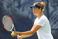 18 March 2012:  FIU's Rita Maisak prepares to serve during her doubles match against Columbia's Bianca Sanon and Tiana Takenaga as the Columbia Lions defeated the FIU Golden Panthers, 5-2, at University Park in Miami, Florida.