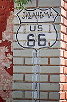 Oklahoma US 66 shield painted on a building in Quapaw Oklahoma on Route 66.