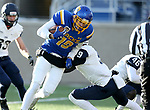 BROOKINGS, SD - DECEMBER 9: Jake Wieneke #19 from South Dakota State University pushes past Isiah Perkins #9 from the University of New Hampshire for a touchdown during their FCS quarterfinal game Saturday afternoon at Dana J. Dykhouse Stadium in Brookings, SD. (Photo by Dave Eggen/Inertia)