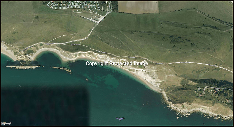 BNPS.co.uk (01202 558833).Pix: Google Earth..***Please Use Full Byline***..A massive cliff has struck the Dorset Jurassic coast today near Durdle Door. Tens of thousands of tones of rock has come crashing down onto a remote beach in St Oswalds Bay. The MCA helicopter spotted the fall.