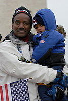 Curtis Martin, 60, with his son Zacharias, 3, from Kentucky amongst the crowd which filled The Mall during the Opening Inaugural Celebration two days before the inauguration of Barack Obama as the 44th President of the United States.