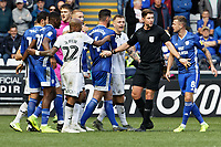 Referee Robert Jones is trying to calm players down during the Sky Bet Championship match between Swansea City and Cardiff City at the Liberty Stadium, Swansea, Wales, UK. Sunday 27 October 2019