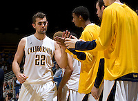 Harper Kamp of California gives high fives with his teammates after making big plays during the game against San Diego at Haas Pavilion in Berkeley, California on November 1st, 2011.  California defeated San Diego, 88-53.
