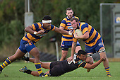 Tamati Fromm tries to break free from Liam Daniela's tackle. Counties Manukau Premier Club Rugby game between Patumahoe & Bombay, played at Patumahoe on Saturday June 18th 2016. Patumahoe won the game 27 - 15 after leading 9 - 3 at halftime. Photo by Richard Spranger.