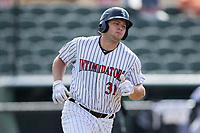 Jake Burger (31) of the Kannapolis Intimidators hustles down the first base line against the Hagerstown Suns at Kannapolis Intimidators Stadium on July 9, 2017 in Kannapolis, North Carolina.  The Intimidators defeated the Suns 3-2 in game one of a double-header.  (Brian Westerholt/Four Seam Images)