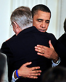Washington, D.C. - March 23, 2010 -- United States President Barack Obama hugs U.S. Senate Majority Leader Harry Reid (Democrat of Nevada) after signing the version of the health care bill that was passed by the U.S. House of Representatives in the East Room of the White House in Washington, D.C. on Tuesday, March 23, 2010..Credit: Ron Sachs / CNP.(RESTRICTION: NO New York or New Jersey Newspapers or newspapers within a 75 mile radius of New York City)