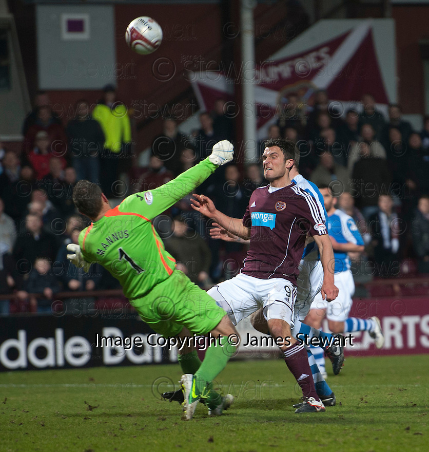 St Johnstone keeper Alan Mannus stops Hearts' John Sutton at close range.