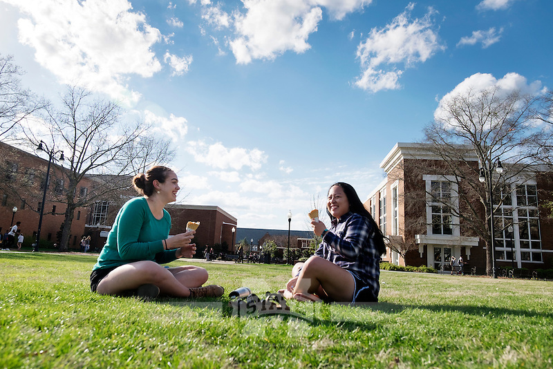Friends enjoy MSU ice cream cones on the Drill Field: Zoe Fokakis (Chemistry major) and Elizabeth Smith (Business Administration).<br />