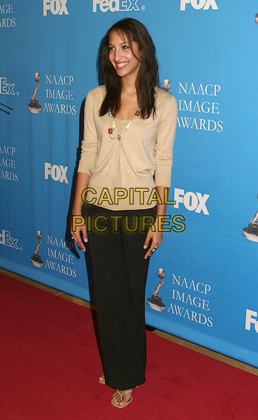 CHRISTEL KHALIL.37th NAACP Image Awards Nominee Luncheon held at the Beverly Hilton Hotel, Beverly Hills, California, USA..February 11th, 2006.Photo: Byron Purvis/AdMedia/Capital Pictures.Ref: BP/ADM.full length beige cardigan black trousers.www.capitalpictures.com.sales@capitalpictures.com.© Capital Pictures.