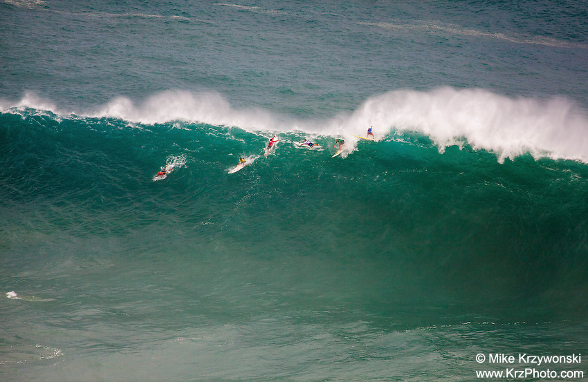 Surfers riding a wave at the 2016 Big Wave Eddie Aikau Contest, Waimea Bay, North Shore, Oahu