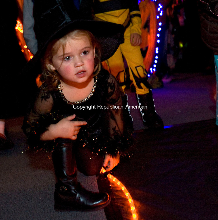 MIDDLEBURY, CT - 21 OCTOBER 2008 -102108JT04--<br /> Emma Pfeiffer, 3, dressed as a witch, is mesmerized by a mini-bowling game during the Middlebury Public Library's &quot;Almost Haunted House&quot; on Tuesday. The annual event offered games, snacks, and spooky decorations.<br /> Josalee Thrift / Republican-American