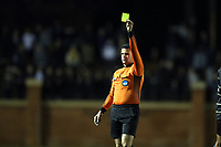 WINSTON-SALEM, NC - DECEMBER 01: Referee Rubiel Vazquez shows the yellow card during a game between Michigan and Wake Forest at W. Dennie Spry Stadium on December 01, 2019 in Winston-Salem, North Carolina.
