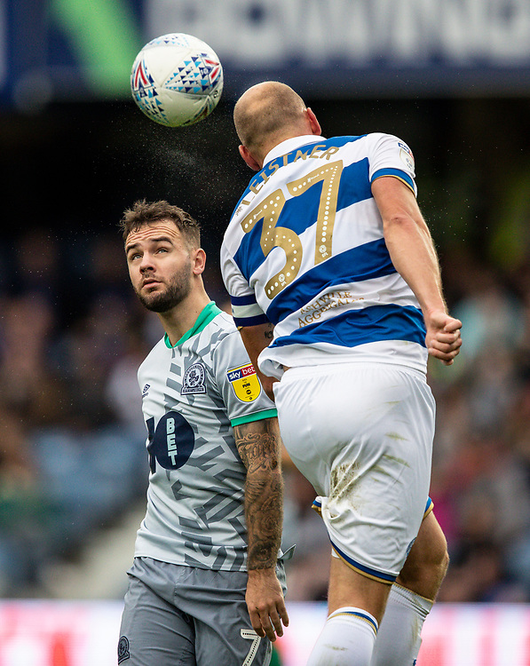 Blackburn Rovers' Adam Armstrong competing with Queens Park Rangers' Toni Leistner (right) <br /> <br /> Photographer Andrew Kearns/CameraSport<br /> <br /> The EFL Sky Bet Championship - Queens Park Rangers v Blackburn Rovers - Saturday 5th October 2019 - Loftus Road - London<br /> <br /> World Copyright © 2019 CameraSport. All rights reserved. 43 Linden Ave. Countesthorpe. Leicester. England. LE8 5PG - Tel: +44 (0) 116 277 4147 - admin@camerasport.com - www.camerasport.com