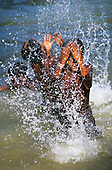 Bacaja Village, Brazil. Xicrin Indian boys playing in the river. Para State, Xingu Indigenous Reserve.