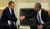 United States President Barack Obama, right, shakes hands with King Felipe VI of Spain, left, following a bilateral meeting in the Oval Office of the White House in Washington, DC on Tuesday, September 15, 2015.<br /> Credit: Dennis Brack / Pool via CNP