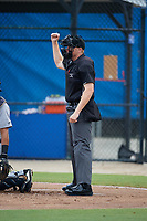 Umpire Jacob McConnell calls a strike during a Gulf Coast League game between the GCL Tigers West and GCL Blue Jays on August 3, 2019 at the Englebert Complex in Dunedin, Florida.  GCL Blue Jays defeated the GCL Tigers West 4-3.  (Mike Janes/Four Seam Images)