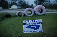 Pro hog farming sign near Warsaw, North Carolina Wednesday, November 14, 2018. (Justin Cook)