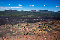 Seen from atop Cinder Cone, the Painted Dunes were created when volcanic ash fell on hot lava beds and oxidized, giving it reddish hues. The Fantastic Lava Beds, which flowed out of Cinder Cone in the 1650s, are just beyond the dunes.