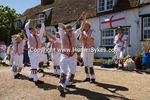 Thaxted Morris dancing outside a typical village country pub Essex England 2006