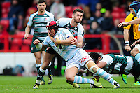 Chris Masoe of Racing 92 is tackled by Owen Williams of Leicester Tigers. European Rugby Champions Cup semi final, between Leicester Tigers and Racing 92 on April 24, 2016 at The City Ground in Nottingham, England. Photo by: Patrick Khachfe / JMP