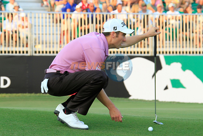 Ross Fisher lines up his putt on the 18th green during Day 3 of the Dubai World Championship, Earth Course, Jumeirah Golf Estates, Dubai, 27th November 2010..(Picture Eoin Clarke/www.golffile.ie)