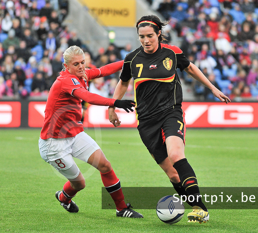 20130925 - OSLO , NORWAY : Belgian Cecile De Gernier (7) pictured with Norwegian Solveig Gulbrandsen (8)  during the female soccer match between Norway and Belgium , on the second matchday in group 5 of the UEFA qualifying round to the FIFA Women World Cup in Canada 2015 at the Ullevaal Stadion , Oslo . Wednesday 25th September 2013. PHOTO DAVID CATRY