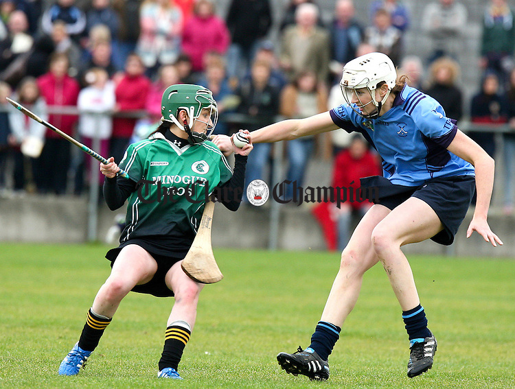 071012.Truagh/Clonlaras Teresa Nihill puts pressure on Scariff Ogonnelloes Sarah O'Donnell during the Intermediate Final at Clarecastle on Sunday.