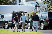 United States Senator Rand Paul (Republican of Kentucky), left, walks across the South Lawn after returning to the White House from a round of golf with President Trump at his golf course, Trump National in Virginia on April 2, 2017 in Washington, DC. A White House spokesperson said they discussed a variety of topics, including healthcare.      <br /> Credit: Pete Marovich / Pool via CNP