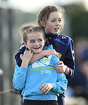 Newmarket friends Maeve O Flanagan and Emma Freeman make their own fun at half time during the senior county final in Clarecastle. Photograph by John Kelly.