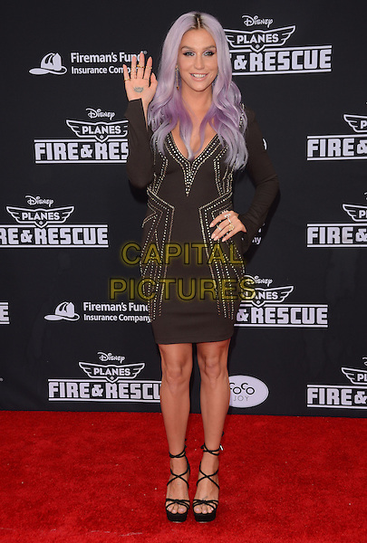 15 July 2014 - Hollywood, California - Kesha. Arrivals for the premiere of Disney's &quot;Planes: Fire and Rescue&quot; held at the El Capitan Theater in Hollywood, Ca. <br /> CAP/ADM/BT<br /> &copy;BT/ADM/Capital Pictures