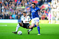 Lee Tomlin of Cardiff City is fouled by Rhian Brewster of Swansea City during the Sky Bet Championship match between Cardiff City and Swansea City at the Cardiff City Stadium in Cardiff, Wales, UK. Sunday 12 January 2020