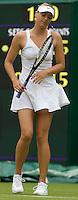Maria Sharapova (RUS) (24) against Viktoriya Kutuzova (UKR) in the first round of the Ladies SIngles. Sharapova beat Kutuzova 7-5 6-4  ..Tennis - Wimbledon - Day 1 - Mon 22nd June 2009 - All England Lawn Tennis Club  - Wimbledon - London - United Kingdom..Frey Images, Barry House, 20-22 Worple Road, London, SW19 4DH.Tel - +44 20 8947 0100.Cell - +44 7843 383 012..