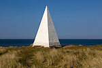 Emmanuel Head white pyramidal navigation beacon, Holy Island, Northumberland, England, UK built 1801-10 by Trinity House