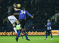 Bolton Wanderers' Mark Beevers heads under pressure from Sheffield Wednesday's Michael Hector <br /> <br /> Photographer Andrew Kearns/CameraSport<br /> <br /> The EFL Sky Bet Championship - Sheffield Wednesday v Bolton Wanderers - Tuesday 27th November 2018 - Hillsborough - Sheffield<br /> <br /> World Copyright &copy; 2018 CameraSport. All rights reserved. 43 Linden Ave. Countesthorpe. Leicester. England. LE8 5PG - Tel: +44 (0) 116 277 4147 - admin@camerasport.com - www.camerasport.com