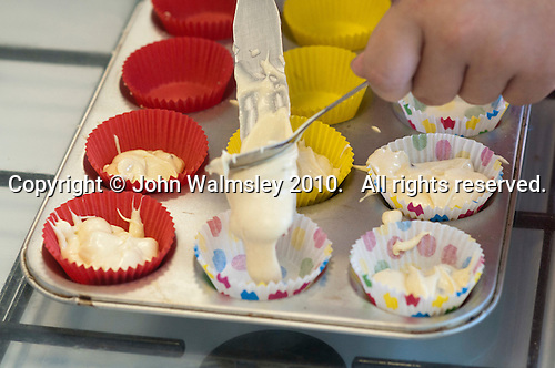 Students making cup cakes, state secondary school.