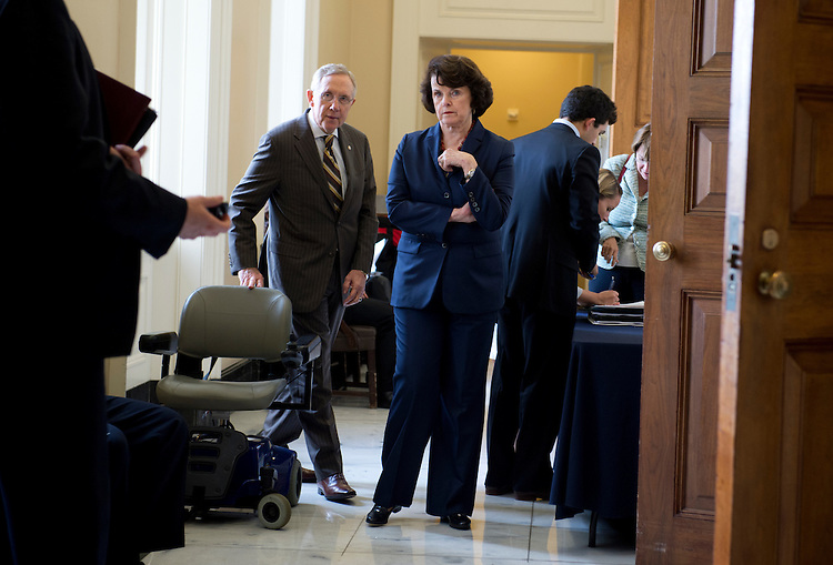 UNITED STATES - JULY 31:  Senate Majority Leader Harry Reid, D-Nev., and Sen. Dianne Feinstein, D-Calif., make their way to the senate luncheons in the Capitol.  (Photo By Tom Williams/CQ Roll Call)