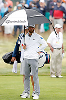 Dustin Johnson (USA) stands under an umbrella on the 5th hole during the second round of the 118th U.S. Open Championship at Shinnecock Hills Golf Club in Southampton, NY, USA. 15th June 2018.<br /> Picture: Golffile | Brian Spurlock<br /> <br /> <br /> All photo usage must carry mandatory copyright credit (&copy; Golffile | Brian Spurlock)