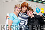 Shane Finn receiving a heroes welcome at O'Shea's, Blennerville, Tralee on Friday last, before he completes his 24th marathon, l-r: Eileen Scanlon, Breda Quirke and Ciara Sheehan, (Camp and Castlegregory).