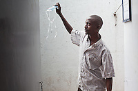 "Julius Irungu, 30, will finish his treatment for MDR-TB in May 2011. When he arrived for treatment 2 years ago he could barely walk 100 yards. "" Look how beautiful i am now!"" he said."