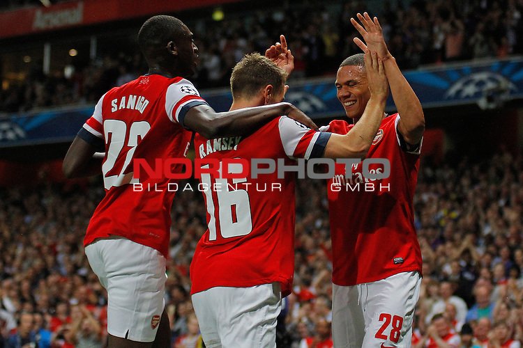 LONDON, ENGLAND - August 27: Arsenal's Yaya Sanogo Arsenal's Aaron Ramsey  and Arsenal's Kieran Gibbs celebrates the 2nd goal during the UEFA Champions League Qualification round match between Arsenal from England and Fenerbahce from Turkey played at The Emirates Stadium, on August 27, 2013 in London, England.   Foto © nph / Mitchell Gunn *** Local Caption ***