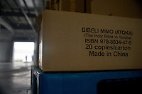 "Bibles printed in Yoruba, a west African tribal language, sit boxed in a warehouse ready for shipment from the Amity Printing Company's new printing facility in Nanjing, China.  The boxes say ""Bibeli Mimo (Atoka) (The Holy Bible in Yoruba) Made in China.""..On May 18, 2008, the Amity Printing Company in Nanjing, Jiangsu Province, China, inaugurated its new printing facility in southern Nanjing.  The facility doubles the printing capacity of the company, now up to 12 million Bibles produced in a year, making Amity Printing Company the largest producer of Bibles in the world.  The company, in cooperation with the international organization the United Bible Societies, produces Bibles for both domestic Chinese use and international distribution.  The company's Bibles are printed in Chinese and many other languages.  Within China, the Bibles are distributed both to registered and unregistered Christians who worship in illegal ""house churches."""