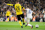 Real Madrid's Lucas Vazquez and Borussia Dortmund Lukasz Pisczek during the UEFA Champions League match between Real Madrid and Borussia Dortmund at Santiago Bernabeu Stadium in Madrid, Spain. December 07, 2016. (ALTERPHOTOS/BorjaB.Hojas)