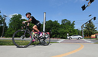 NWA Democrat-Gazette/J.T. WAMPLER  A cyclist rides on the Razorback Greenway trail in Fayetteville Sunday May 13, 2018. A group ride for women led by local cyclist Finn Taylor will be held today at 6 P.M. ((MONDAY MAY 14)) at The Bike Route bicycle shop in Fayetteville. For more information call The Bike Route at (479) 966-4050.