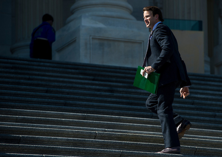 UNITED STATES - FEBRUARY 27: Rep. Aaron Schock, R-Ill., walks up the House steps to the Capitol for a series of votes on Thursday, Feb. 27, 2014. (Photo By Bill Clark/CQ Roll Call)