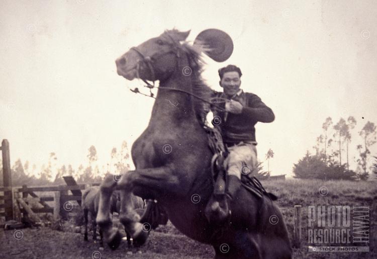 Archival black and white photograph of Yutaka Kimura, the ìWaimea Cowboy,î on bucking horse
