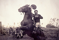 Archival black and white photograph of Yutaka Kimura, the ìWaimea Cowboy,î on bucking horse